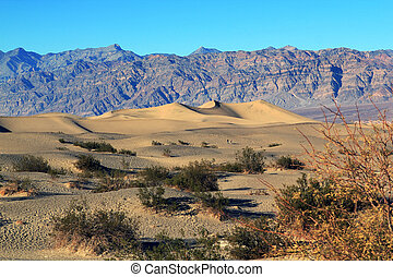 Sand Dunes - Ripples And Mountain Peaks. Death Valley...