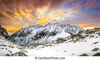 Panoramic view of white winter mountains after colorful...