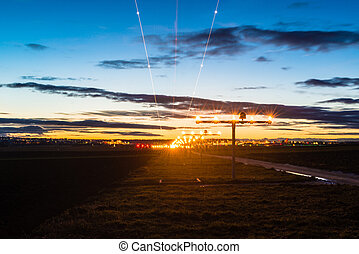 Approaching the airport at dusk - Airport at dusk with...