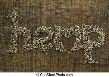 The word Hemp written artistically in hemp seeds on a wooden...