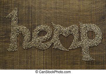 The word Hemp written artistically in hemp seeds on a wooden...