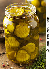 Homemade Organic Crunch Green Pickles in a Jar
