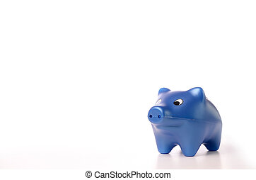 Piggy bank - Blue piggy bank on a white table