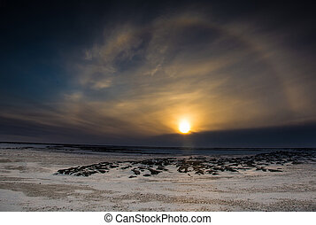 Sun dog at sunset - A sun dog around at sunset over the...
