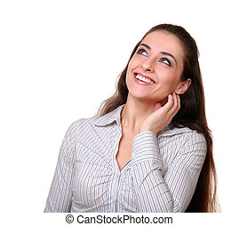Thinking woman looking up with happy smile isolated on white