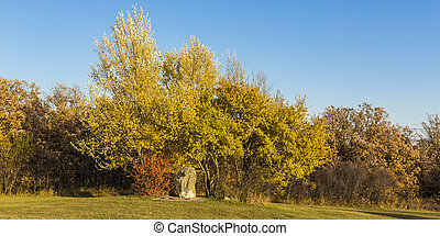 Religous Stone in Fall - The autumn colors surround an old...