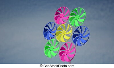 colorful wind mill spin - Closeup of colorful plastic wind...