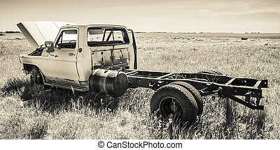Farm Truck in the Field - An old farm truck retired in the...