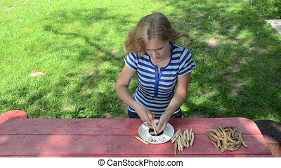 woman unhusk beans dish - beautiful farmer girl shell husk...