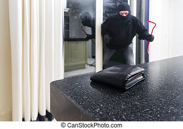 Burglar with a crowbar - Mean looking burglar enters a...