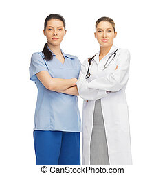 two doctors in uniform - healthcare and medical concept -...