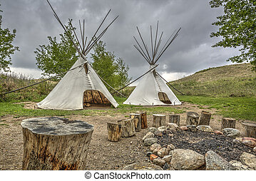 Teepees by a Fire Pit - A tipi (also tepee and teepee) is a...