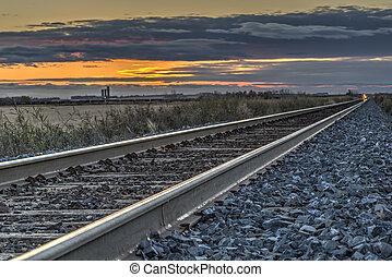 Railroad at Dusk - A railroad line across the prairie...