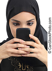 Front view of an arab woman addicted to the smart phone