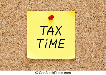 Tax Time Sticky Note - Tax Time written on yellow sticky...