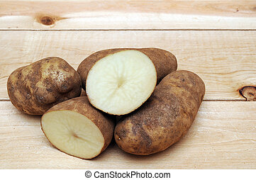 russet potatoes - cutting and whole russet potatoes on...