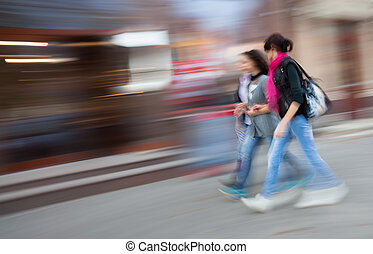Abstract image of young people group going along the street....