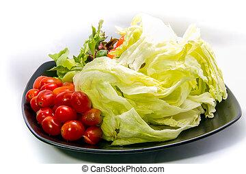 fresh vegetable salad on black plate