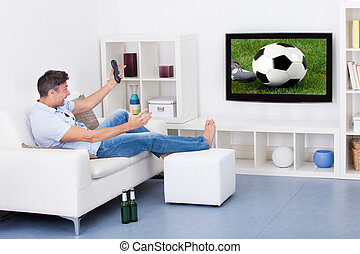 Man Watching Soccer - Portrait Of An Excited Mature Man...