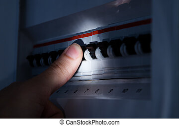 Hand Testing Electrical Board - Close-up Of Hand With Light...