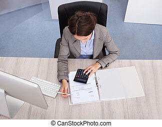 Female Accountant - High Angle View Of Young Female...