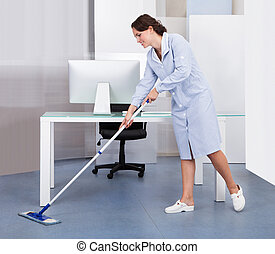 Maid Cleaning Floor In Office - Portrait Of Happy Female...