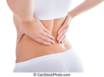 Woman Suffering From Back Pain - Young Woman With Pain In...