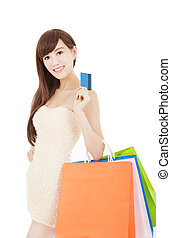 Young woman holding group shopping bag and credit card