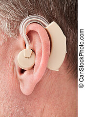 Person Wearing Hearing Aid - Close-up Of A Person Wearing...