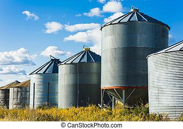 Grain Bins - Grain bins on an old prairie farm.