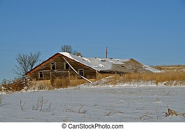 Old Weathered Shed in the Snow - An old weathered shed or...