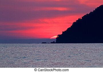 Sunset Behind Island - Sun set behind island in Langkawi,...