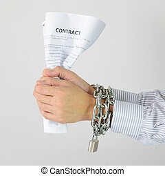 Businessman hands with chains and contract - Businessman...