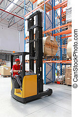 Forklift loading pallet with roll in distribution warehouse