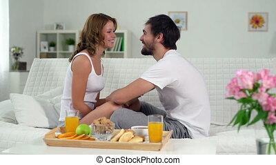 In-home Picnic - Joyful sweethearts having a juicy breakfast...