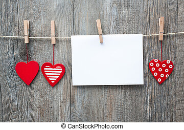 Message in the clothesline - Message and red hearts on the...