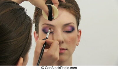 made up - Beauty woman having her made up by stylist