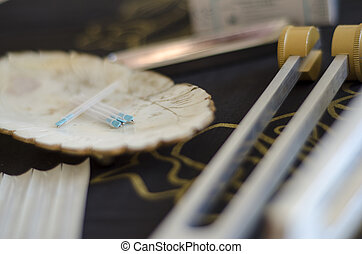 Acupunture needles and healing tuning fork - Close up of...