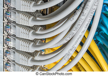 network cables connected to switch - closeup of data center...
