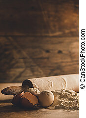 Home baking ingredients on wood