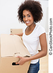 African American woman moving house - beautiful young...