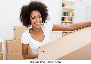 Smiling African American woman in a new home