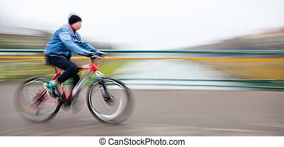 cyclist on the city roadway - Abstract image of cyclist on...