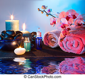 preparation for massage and aromatherapy in blue and red