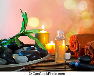preparation for massage in orange with dish, oil and bamboo...