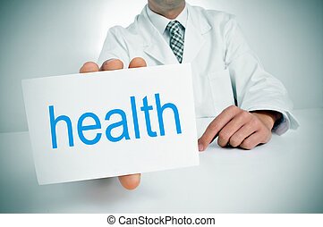 health - a man wearing a white coat showing a signboard with...
