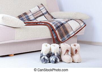 Wool slippers - Real wool slippers and blanked on sofa,...