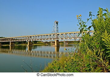 Two Tier Lift Bridge - A two tier lift bridge spans across a...
