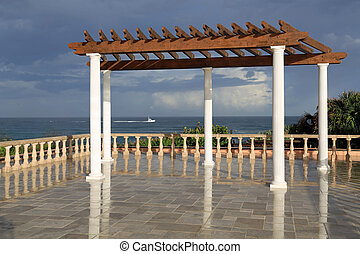 Inviting terrace and pergola overlooking the ocean.