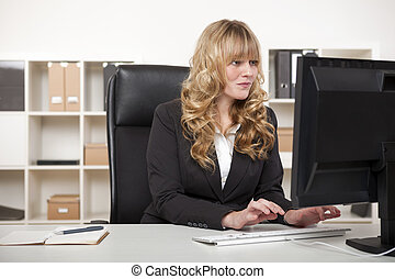 Pretty blond secretary working desk - Pretty blond secretary...
